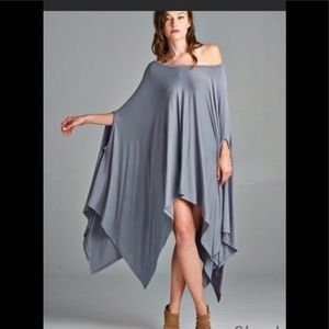 Contemporary poncho with armholes as sleeves